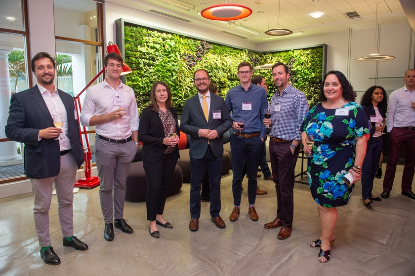 Hiscox team infront of living wall